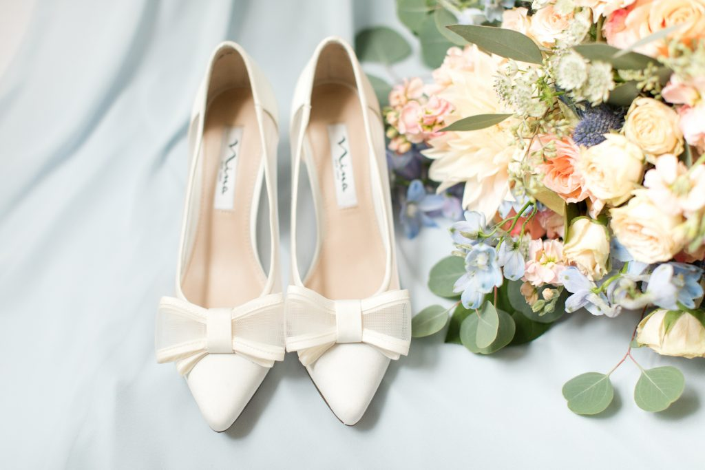 Subtle fall wedding, classic, elegant, peach, blues, hint of orange, blue thistle, roses, eucalyptus, delphinium, shoes.