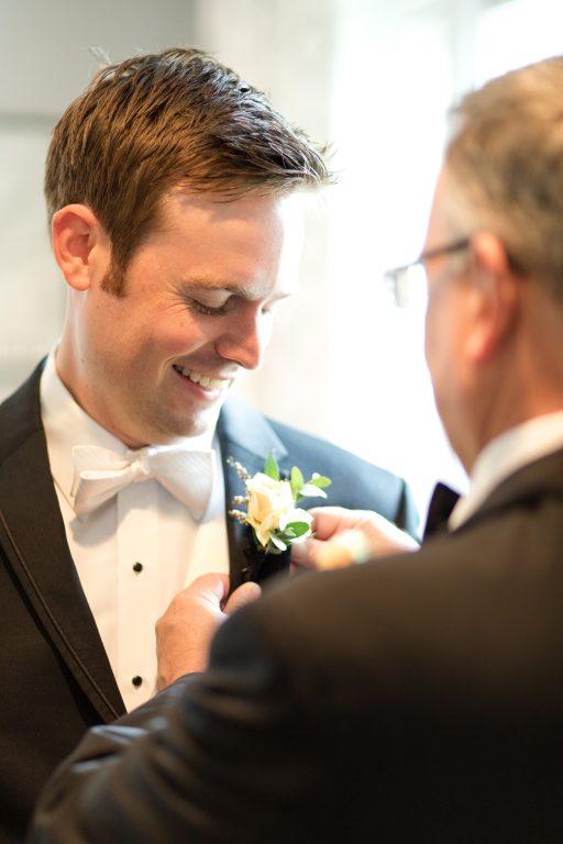 Subtle fall wedding, classic, elegant, peach, blues, hint of orange, blue thistle, roses, eucalyptus, delphinium, groom, boutonniere.