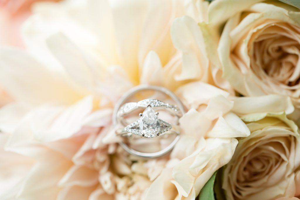 Subtle fall wedding, classic, elegant, peach, blues, hint of orange, blue thistle, roses, eucalyptus, delphinium, rings, florals.