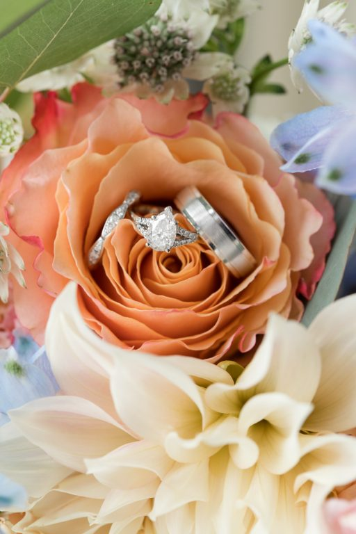 Subtle fall wedding, classic, elegant, peach, blues, hint of orange, blue thistle, roses, eucalyptus, delphinium, rings, florals.