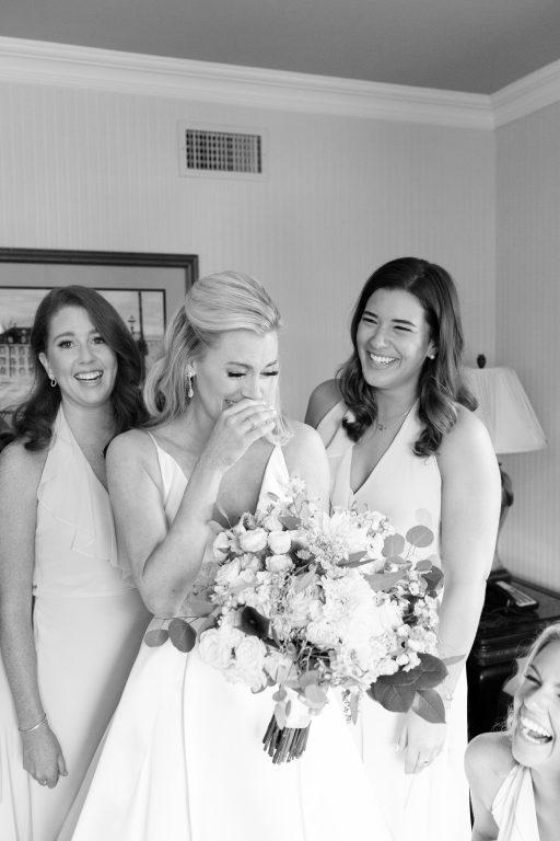 Subtle fall wedding, classic, elegant, peach, blues, hint of orange, blue thistle, roses, eucalyptus, delphinium, bride and bridesmaids.