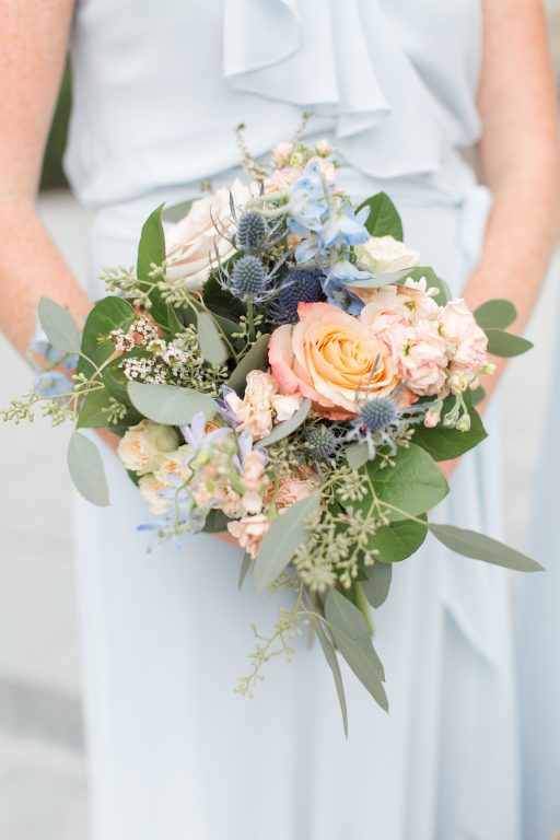 Subtle fall wedding, classic, elegant, peach, blues, hint of orange, blue thistle, roses, eucalyptus, delphinium, bridesmaids bouquet.