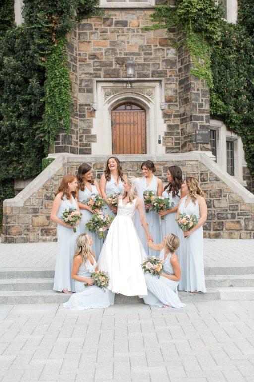 Subtle fall wedding, classic, elegant, peach, blues, hint of orange, blue thistle, roses, eucalyptus, delphinium, bridesmaids and bride.