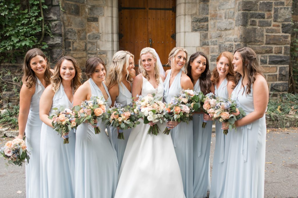 Subtle fall wedding, classic, elegant, peach, blues, hint of orange, blue thistle, roses, eucalyptus, delphinium, bridesmaids and bride.