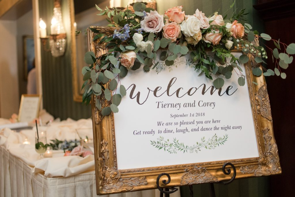 Subtle fall wedding, classic, elegant, peach, blues, hint of orange, blue thistle, roses, eucalyptus, delphinium, welcome sign, vintage frame, floral swag.