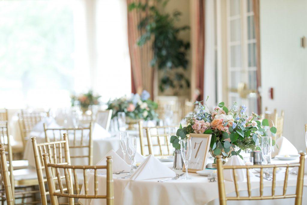 Subtle fall wedding, classic, elegant, peach, blues, hint of orange, blue thistle, roses, eucalyptus, delphinium, centerpiece.