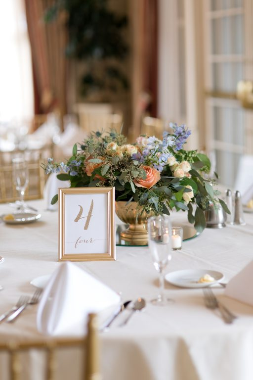 Subtle fall wedding, classic, elegant, peach, blues, hint of orange, blue thistle, roses, eucalyptus, delphinium, centerpiece, gold compote.