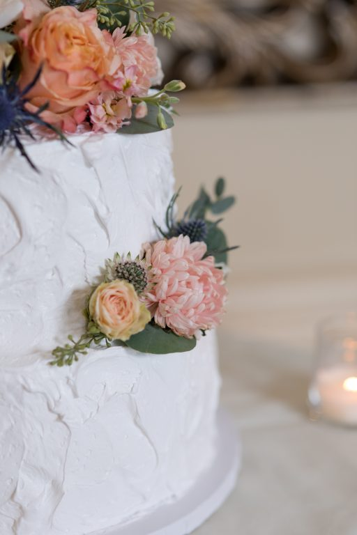 Subtle fall wedding, classic, elegant, peach, blues, hint of orange, blue thistle, roses, eucalyptus, delphinium, cake florals.