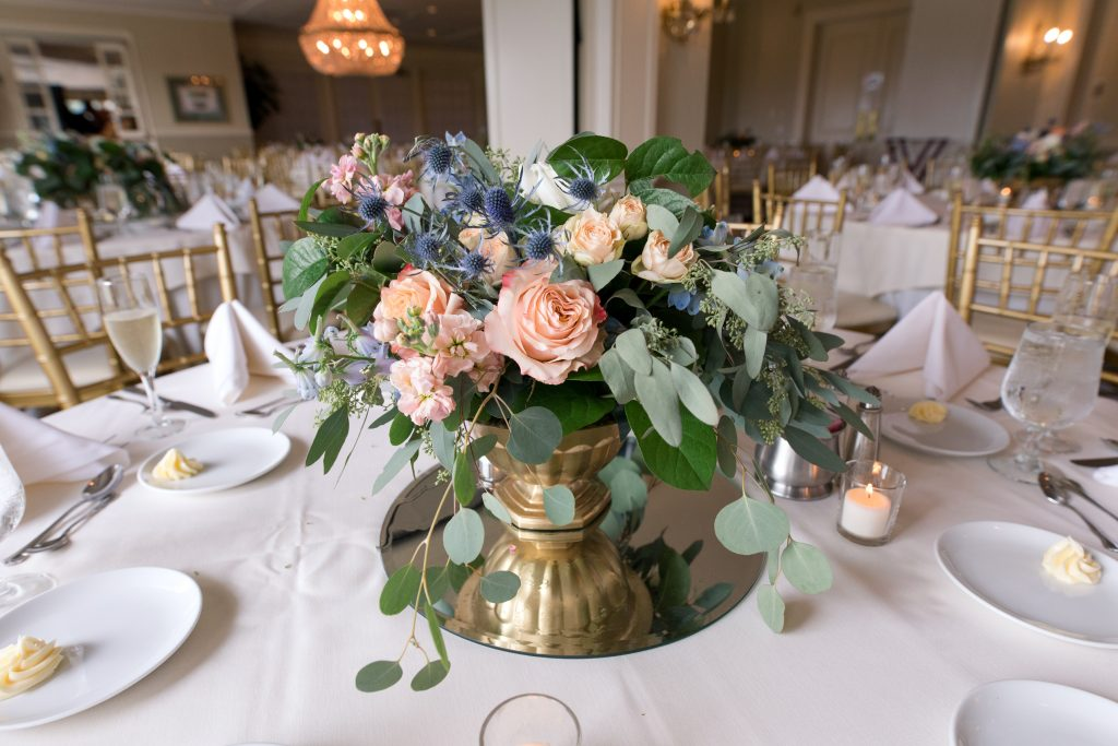 Subtle fall wedding, classic, elegant, peach, blues, hint of orange, blue thistle, roses, eucalyptus, delphinium, centerpiece.