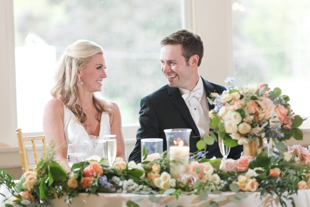 Subtle fall wedding, classic, elegant, peach, blues, hint of orange, blue thistle, roses, eucalyptus, delphinium, bride and groom, sweetheart table.