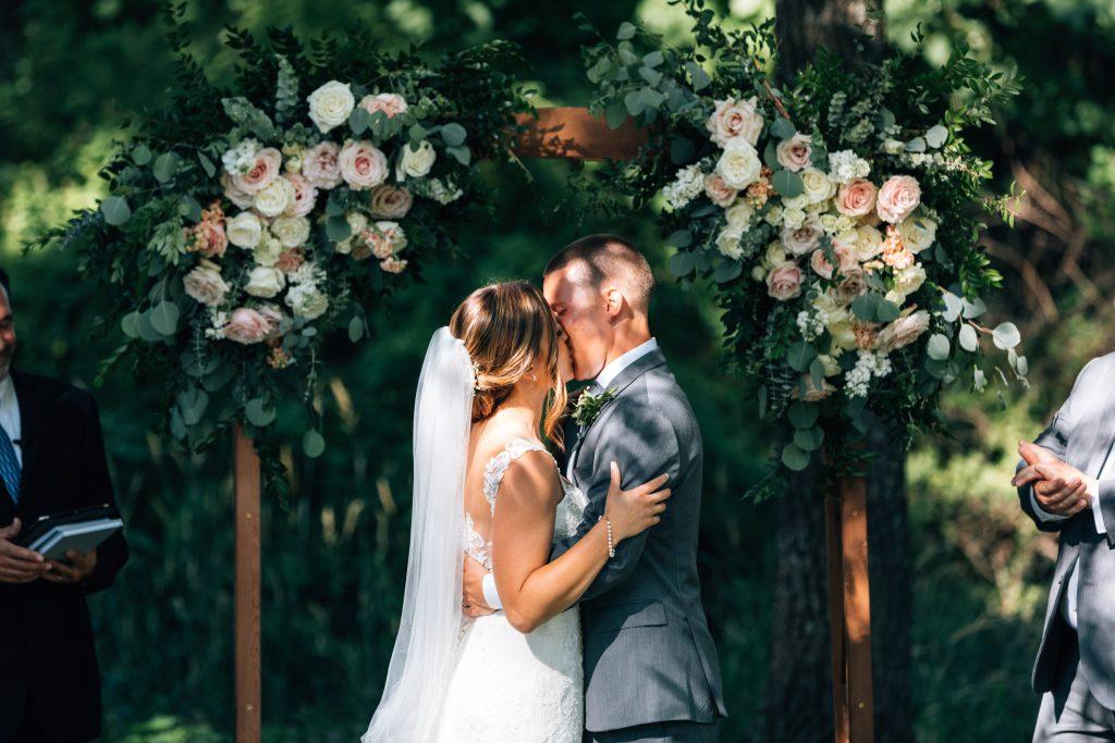 Summer wedding, natural, greenery, light, fresh, peonies, juliet roses, cream, pink, blush, ceremony, bride and groom.