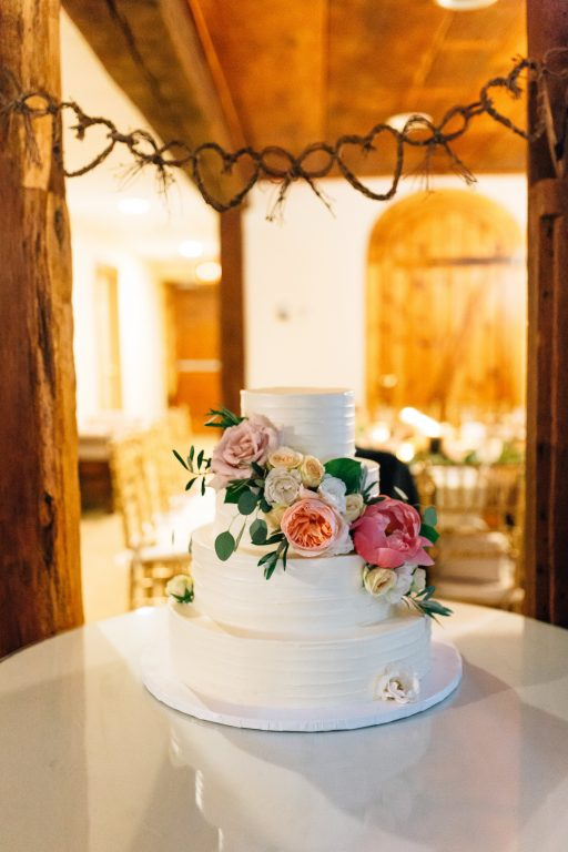 Summer wedding, natural, greenery, light, fresh, peonies, juliet roses, cream, pink, blush, reception, cake, floral swag.