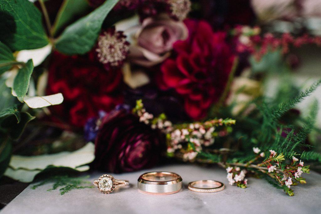 Whimsical, fall, autumn, jewel tones, gardeny, greenery, purples, blues, organic, wedding, bridal bouquet, rings.