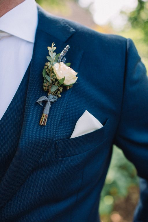 Whimsical, fall, autumn, jewel tones, gardeny, greenery, purples, blues, organic, wedding, groom, boutonniere.