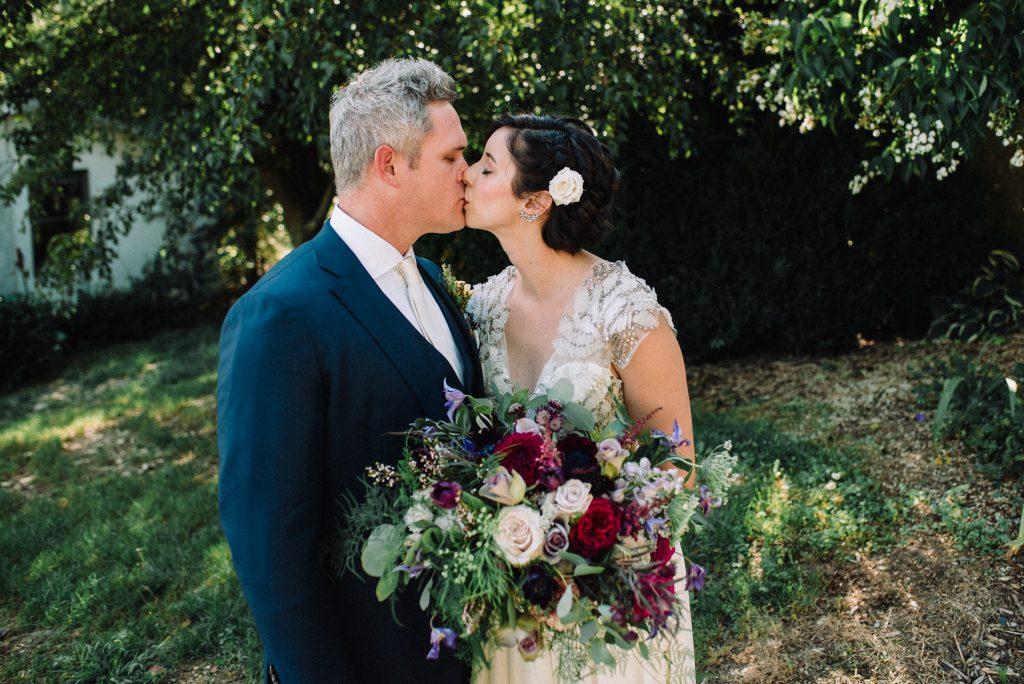 Whimsical, fall, autumn, jewel tones, gardeny, greenery, purples, blues, organic, wedding, bride and groom.