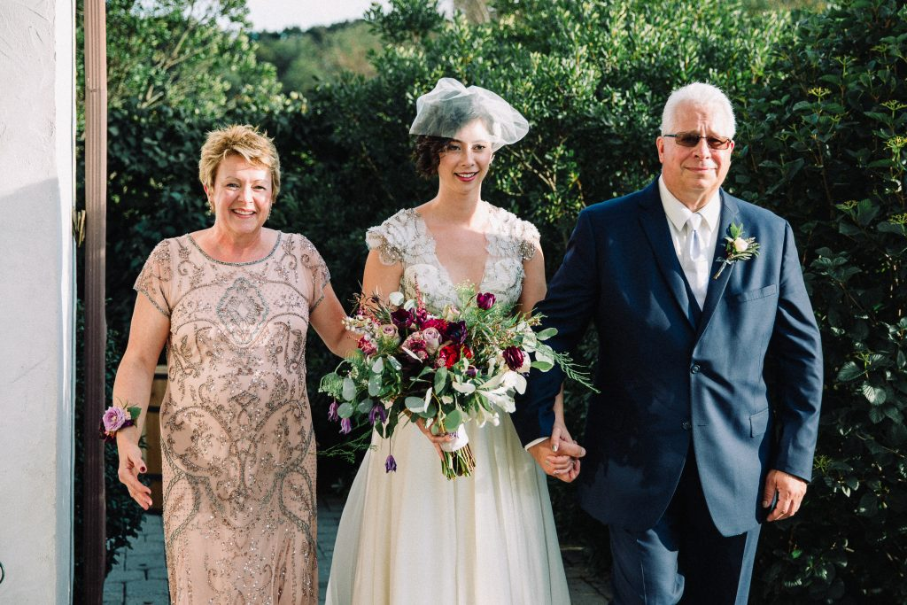 Whimsical, fall, autumn, jewel tones, gardeny, greenery, purples, blues, organic, wedding, bride, mother of the bride, father of the bride, ceremony.