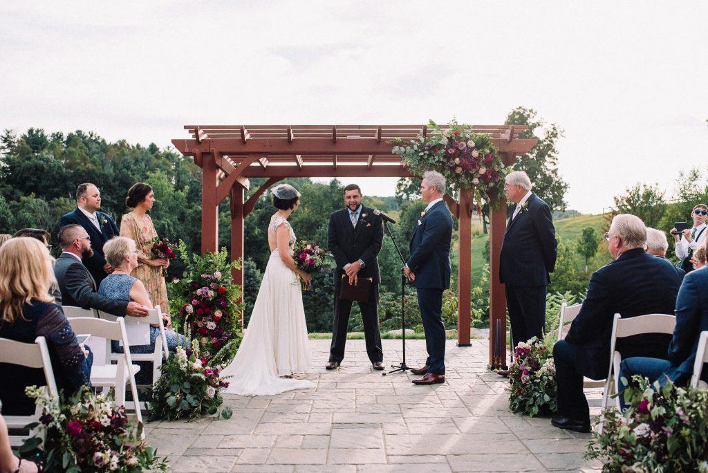 Whimsical, fall, autumn, jewel tones, gardeny, greenery, purples, blues, organic, wedding, bride and groom, ceremony.