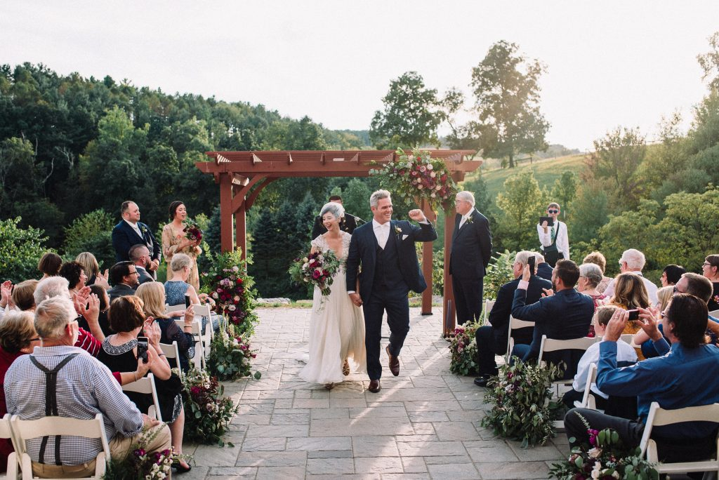 Whimsical, fall, autumn, jewel tones, gardeny, greenery, purples, blues, organic, wedding, ceremony, bride and groom.