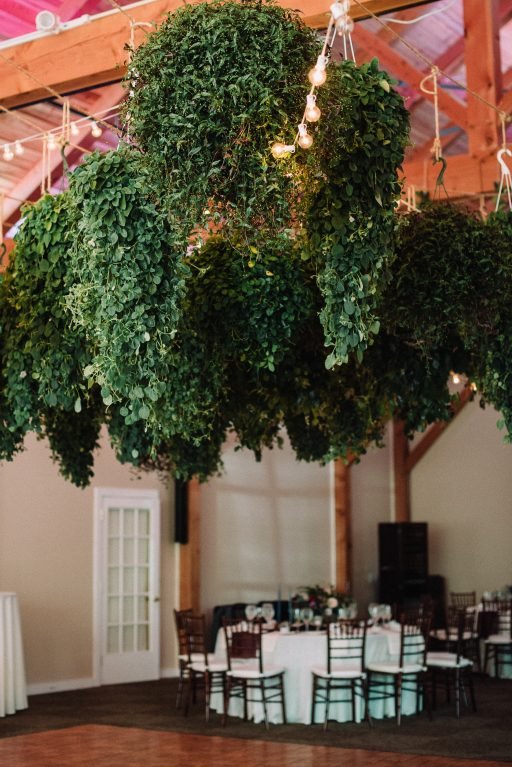 Whimsical, fall, autumn, jewel tones, gardeny, greenery, purples, blues, organic, wedding, greenery chandeliers.