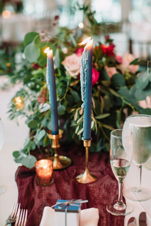 Whimsical, fall, autumn, jewel tones, gardeny, greenery, purples, blues, organic, wedding, sweetheart table, bridal bouquet, taper candles.