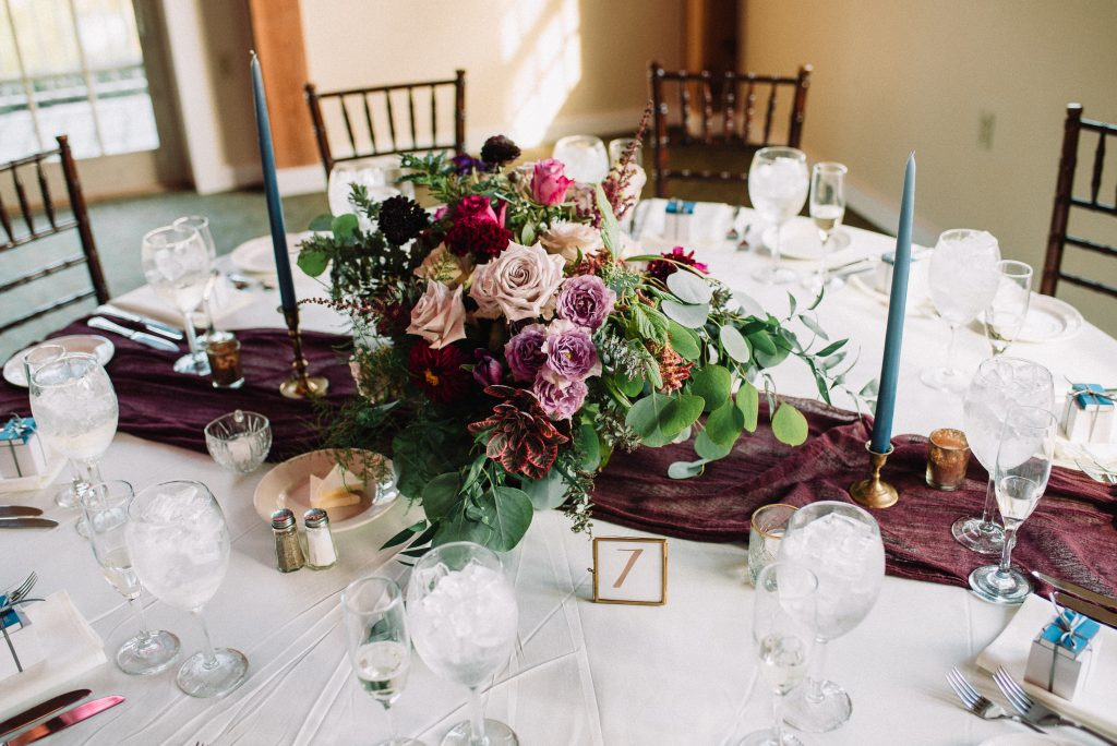 Whimsical, fall, autumn, jewel tones, gardeny, greenery, purples, blues, organic, wedding, centerpieces, taper candles.