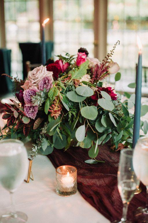 Whimsical, fall, autumn, jewel tones, gardeny, greenery, purples, blues, organic, wedding, centerpiece.