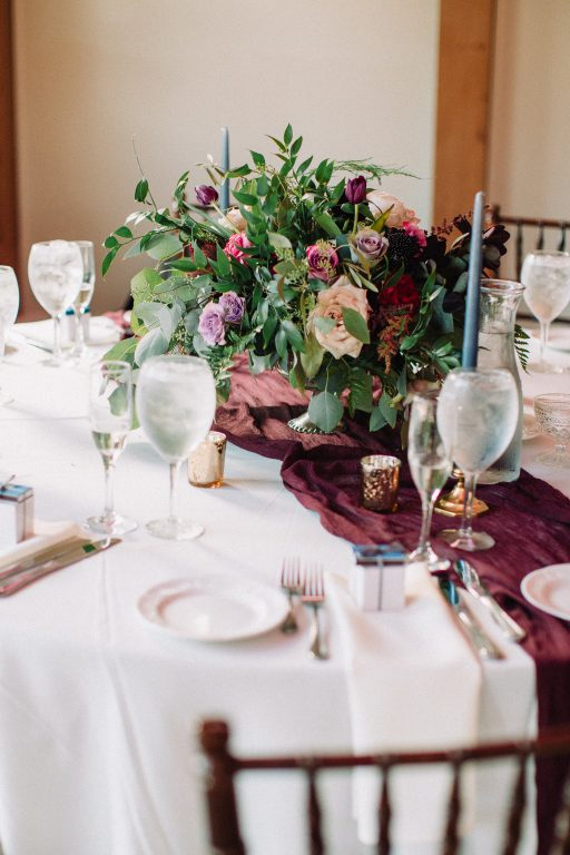 Whimsical, fall, autumn, jewel tones, gardeny, greenery, purples, blues, organic, wedding, centerpiece.