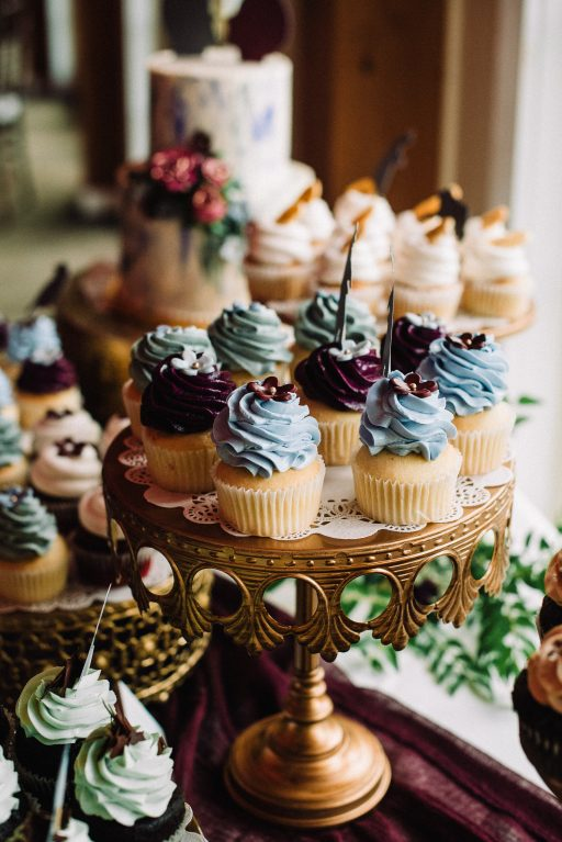 Whimsical, fall, autumn, jewel tones, gardeny, greenery, purples, blues, organic, wedding, dessert display, gold cake stands.