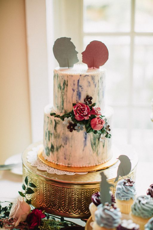 Whimsical, fall, autumn, jewel tones, gardeny, greenery, purples, blues, organic, wedding, cake display, gold cake stand.