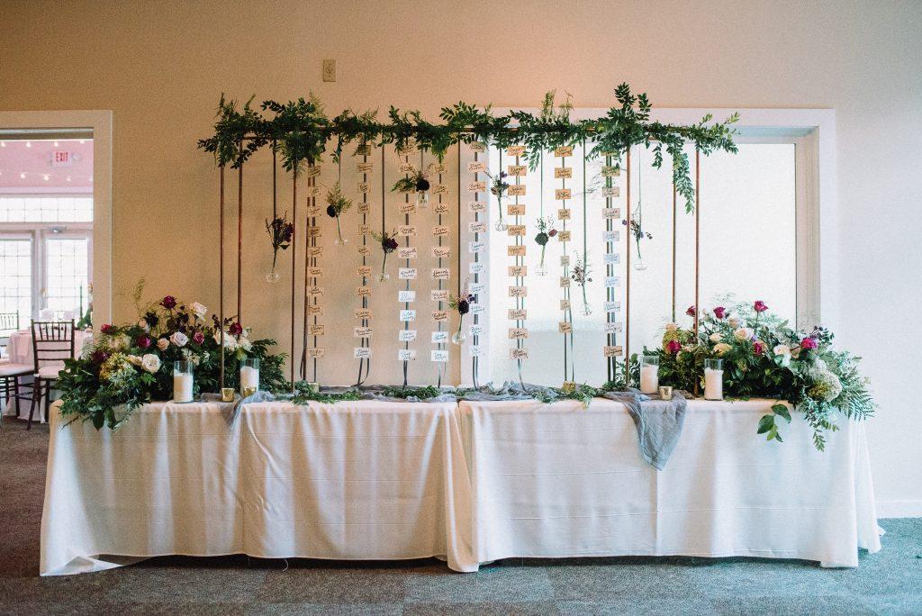 Whimsical, fall, autumn, jewel tones, gardeny, greenery, purples, blues, organic, wedding, escort card display.