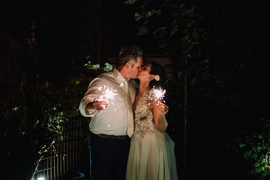 Whimsical, fall, autumn, jewel tones, gardeny, greenery, purples, blues, organic, wedding, bride and groom, sparklers.