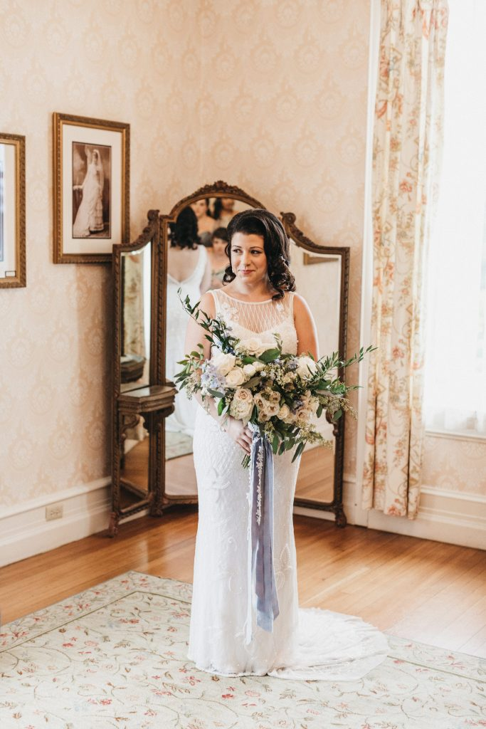 Summer wedding, warm, historic, personal, polished, clean, shades of blue, white, cream, roses, italian ruscus, bride, bridal bouquet, wild, organic shape, florals.