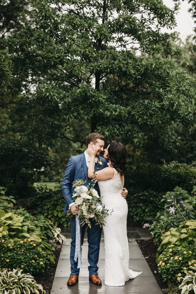 Summer wedding, warm, historic, personal, polished, clean, shades of blue, white, cream, roses, italian ruscus, blue thistle, bride and groom.