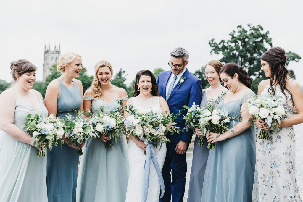Summer wedding, warm, historic, personal, polished, clean, shades of blue, white, cream, roses, italian ruscus, blue thistle, bride, bridesmaids.