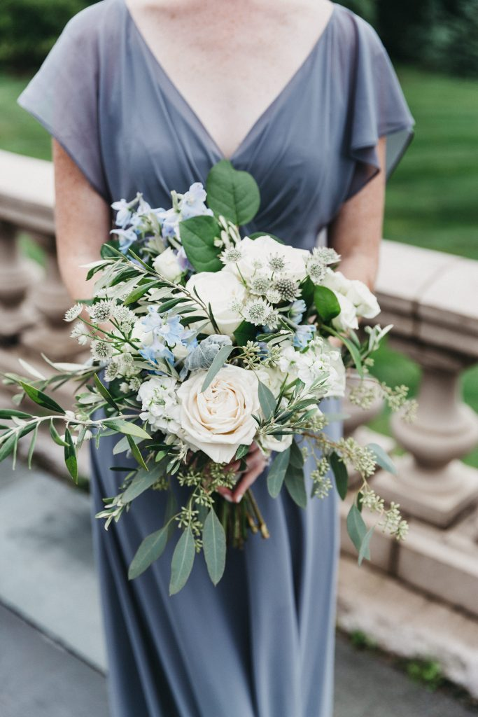 Summer wedding, warm, historic, personal, polished, clean, shades of blue, white, cream, roses, italian ruscus, blue thistle, bridesmaids bouquet, organic shape.