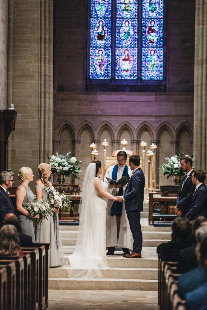 Summer wedding, warm, historic, personal, polished, clean, shades of blue, white, cream, roses, italian ruscus, blue thistle, ceremony, altar arrangements.