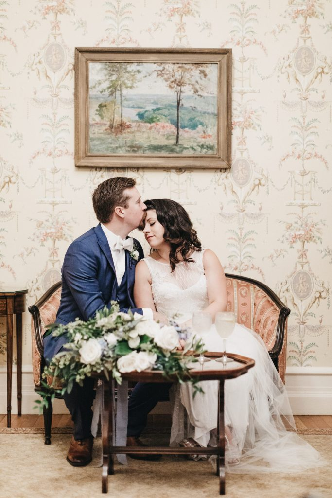 Summer wedding, warm, historic, personal, polished, clean, shades of blue, white, cream, roses, italian ruscus, blue thistle, reception, bride and groom.