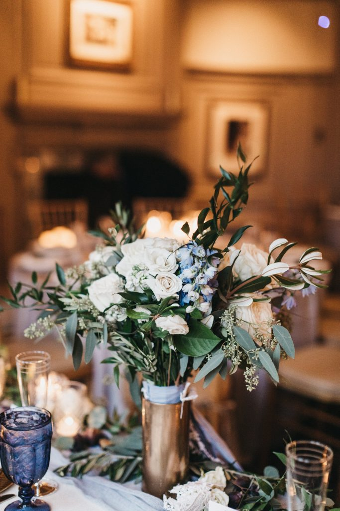 Summer wedding, warm, historic, personal, polished, clean, shades of blue, white, cream, roses, italian ruscus, blue thistle, reception, bridal bouquet, sweetheart table.