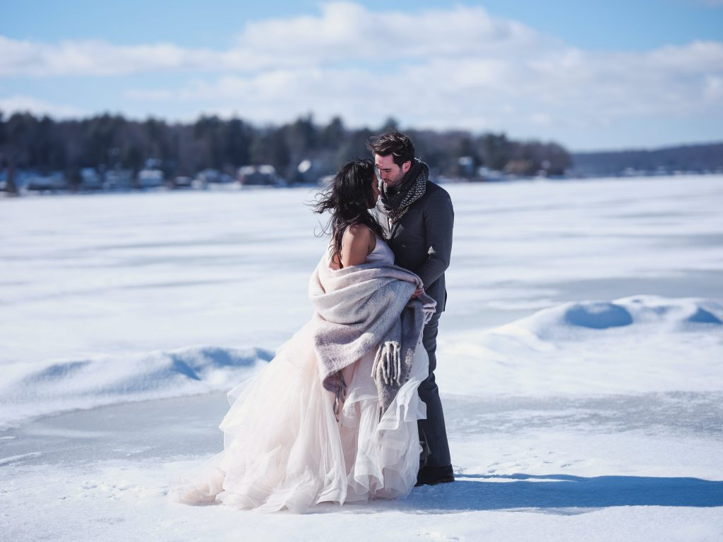 Ice wedding, ice dinner, tule bridal skirt, blush, burgundy, brown, dried florals, winter, frozen lake, styled shoot, bride and groom.