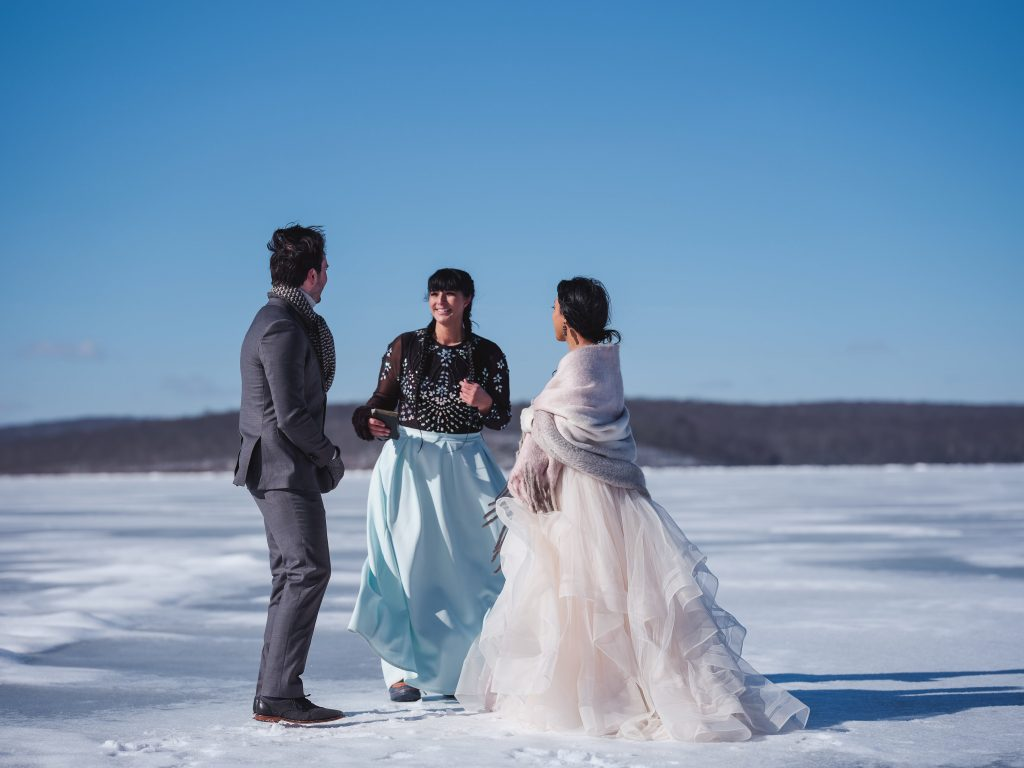 Ice wedding, ice dinner, tule bridal skirt, blush, burgundy, brown, dried florals, winter, frozen lake, styled shoot, bride and groom, ceremony.