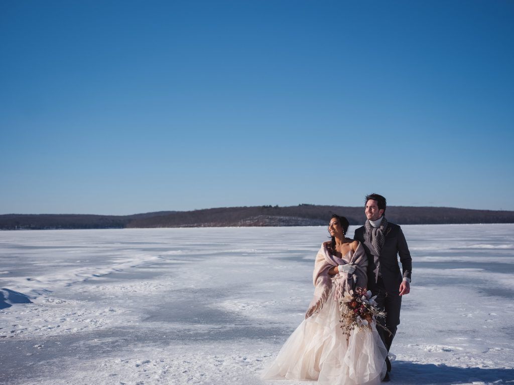 Ice wedding, ice dinner, tule bridal skirt, blush, burgundy, brown, dried florals, winter, frozen lake, styled shoot, bride and groom, bridal bouquet.