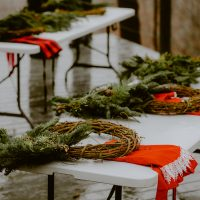 Holiday wreath making workshop, evergreens, mushrooms, oranges, airplants, pinecones, festive, gathering.