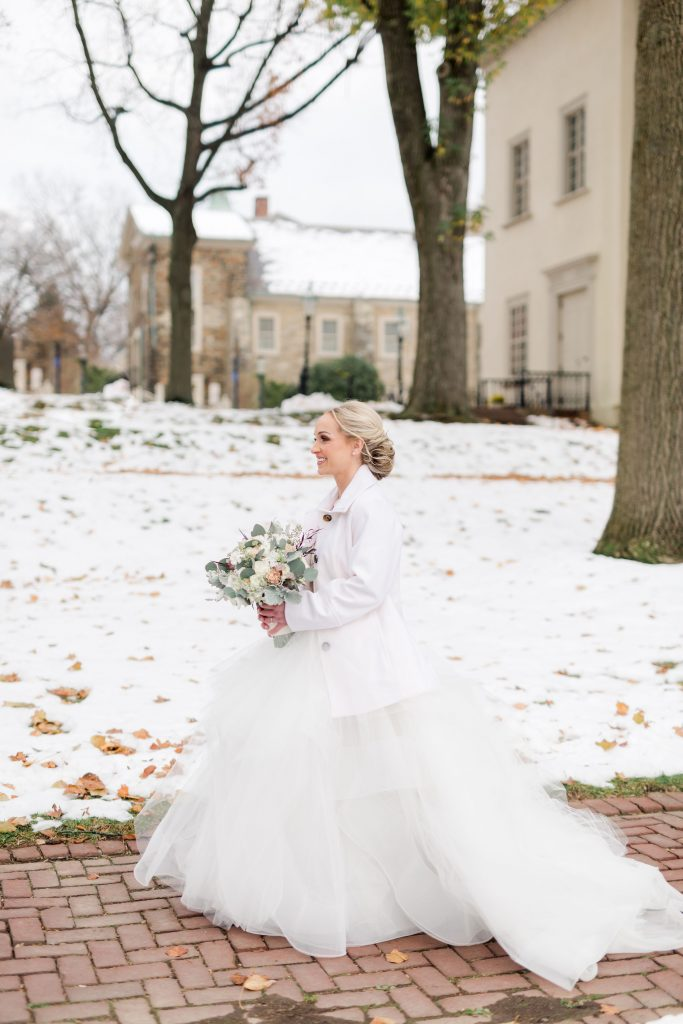 grey-green, plum, cream and a hint of blush, traditional, modern, winter wedding, roses, spray roses, ranunculus, bride and groom, first look.