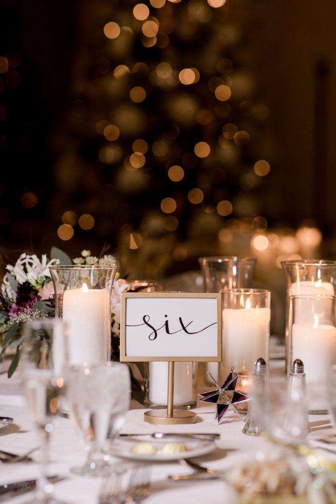 grey-green, plum, cream and a hint of blush, traditional, modern, winter wedding, roses, spray roses, ranunculus, candles, moravian stars, centerpieces.