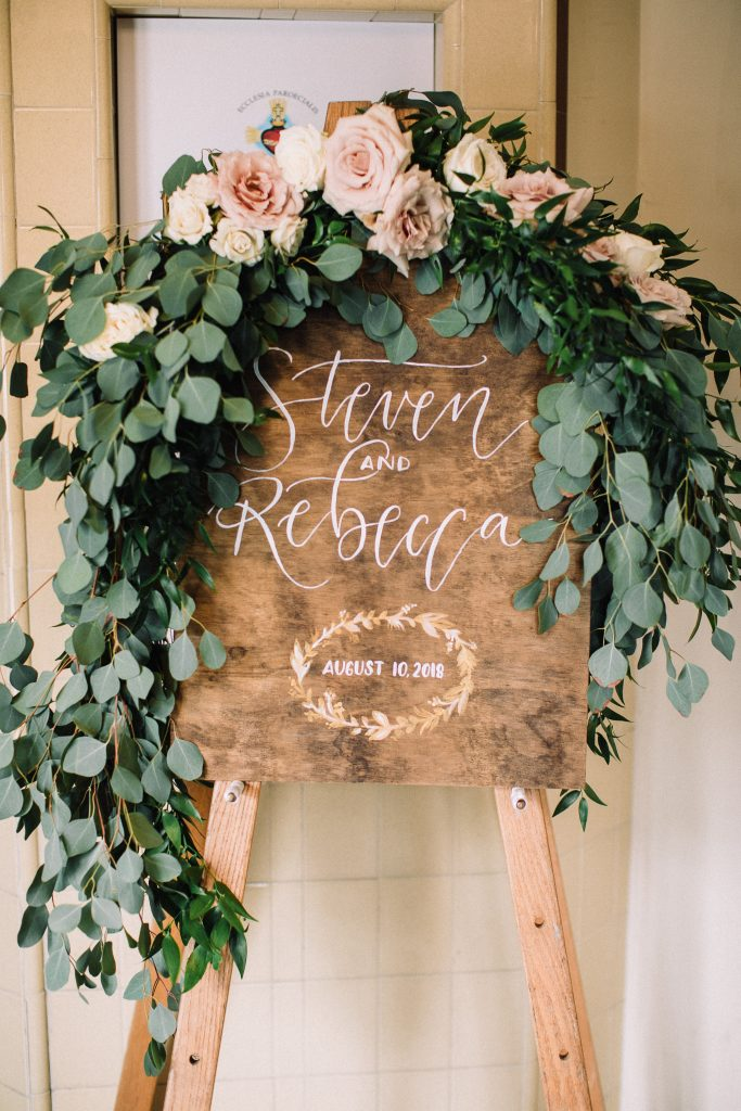 whimsical, boho, enchanted, secret garden, summer wedding, cream, blush, greenery florals, welcome sign, floral and greenery swag.