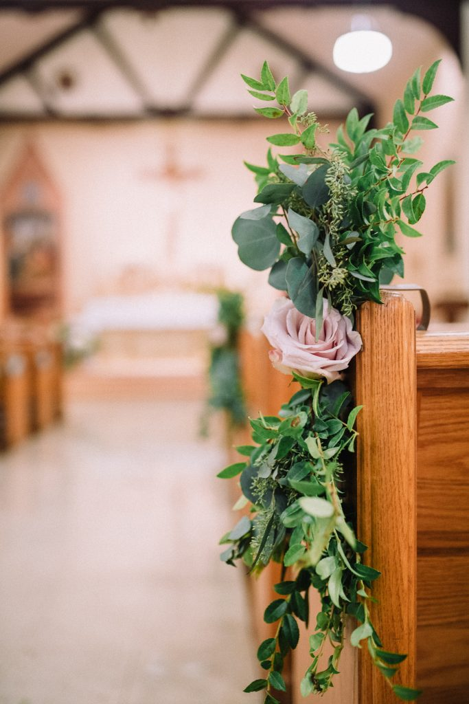 whimsical, boho, enchanted, secret garden, summer wedding, cream, blush, greenery florals, ceremony, pew piece, floral and greenery swag.