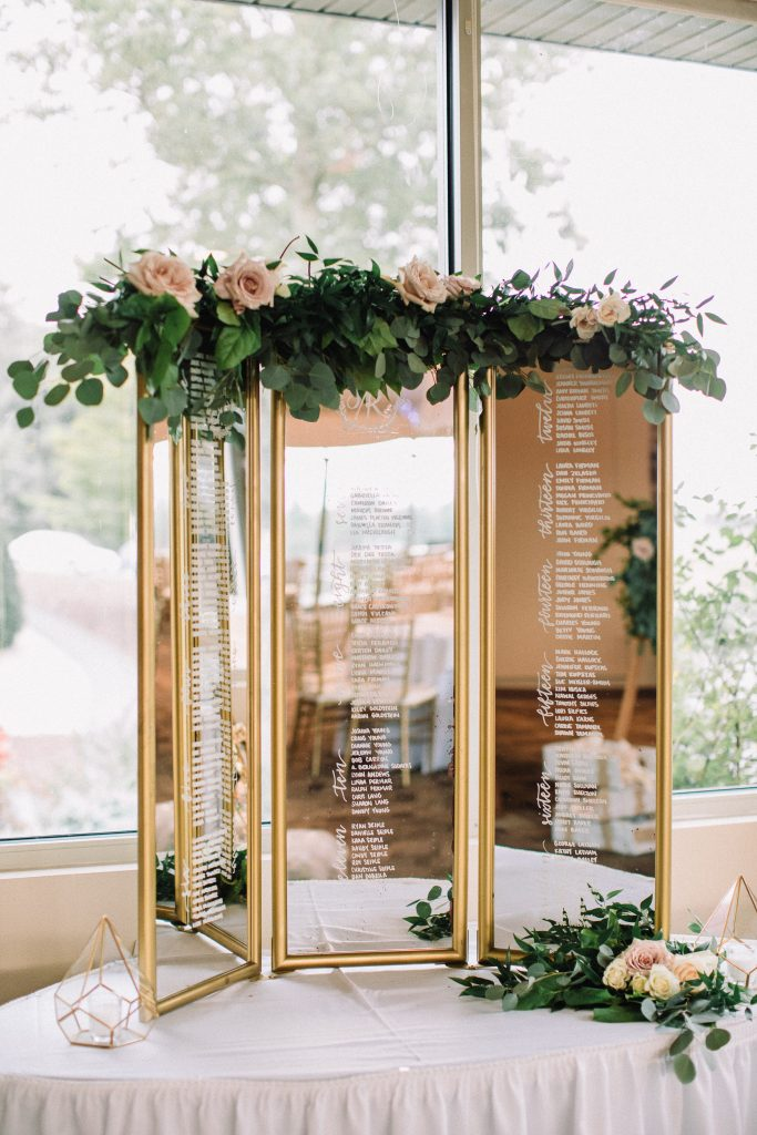 whimsical, boho, enchanted, secret garden, summer wedding, cream, blush, greenery florals, mirror seating chart, floral and greenery swag.