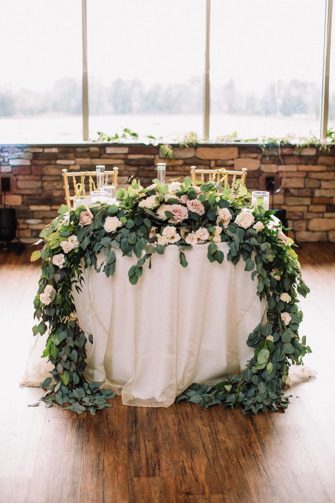 whimsical, boho, enchanted, secret garden, summer wedding, cream, blush, greenery florals, reception, sweetheart table, floral and greenery swag.