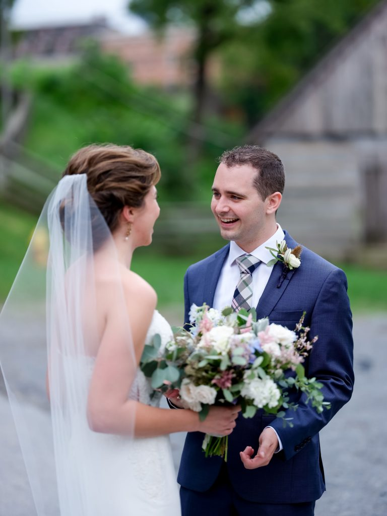warm, loving, striking and fashionable, artistic, fall wedding, navy, slate bluish, pewter, blush, cream, greenery, texture, botanical, asymmetrical, bride and groom, first look.