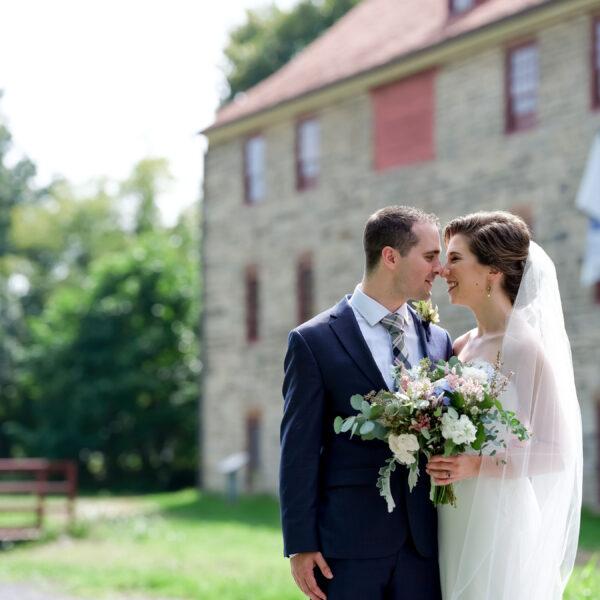 warm, loving, striking and fashionable, artistic, fall wedding, navy, slate bluish, pewter, blush, cream, greenery, texture, botanical, asymmetrical, bride and groom.